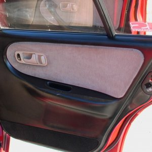 Painted rear passenger door panel
