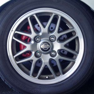 P11 Wheel and Red Calipers